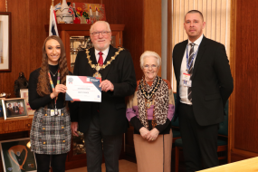 Group photo of Mayor of Bury delivering a certificate to Bury College apprentice
